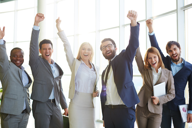 people at work celebrating their productive success.