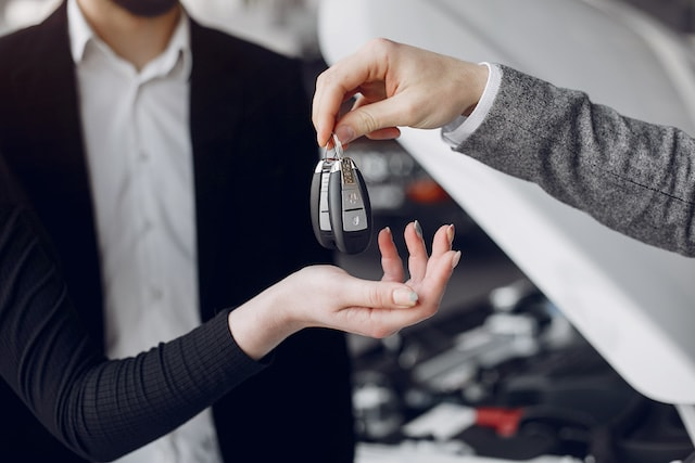 handing over car keys for a rental, which has hidden fees.
