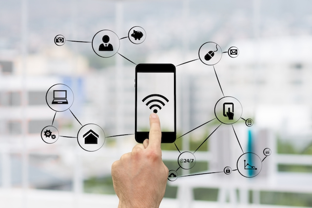 a hand clicking on wifi on a phone and other sources of information around it.