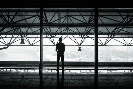 Looking out a window in the airport